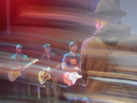 rhysbackthreeguitarists.jpg