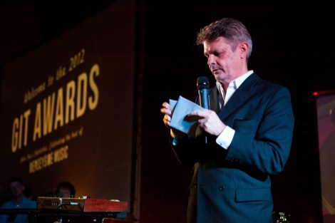 Paul du Noyer opens the envelope at the GIT Award 2012.jpg