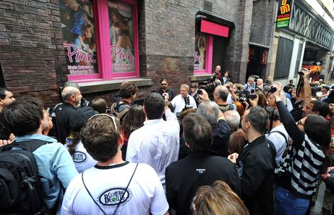 Fans watch on as Andreas Kisser from Brazilian Metal band Sepultura gets his name on the Mathew street Wall of fame.jpg