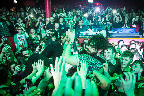 Foals frontman Yannis Philippakis crowdsurfs at the Arts Club