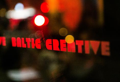 baltic creative window sign at threshold