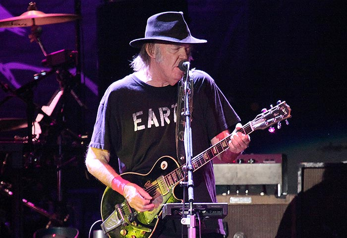 Neil Young performing at The LIverpool Echo Arena