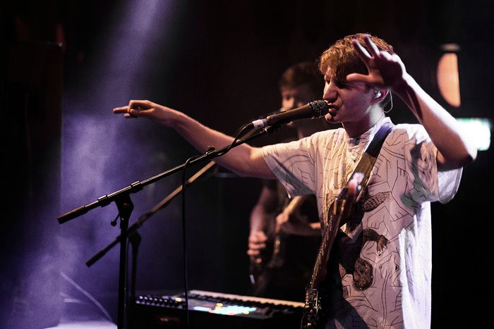 Glass Animals conducting their service.