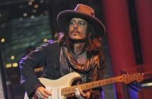 A sickening display: Johnny Depp plays guitar