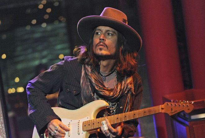 A sickening display: Johnny Depp plays guitar