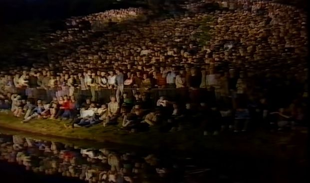Echo & The Bunnymen in Sefton Park 1982 with the crowd watching from the grassy banks and water's edge