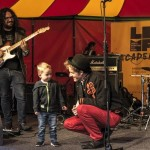 A toddler joins Amique on the LIMF Academy stage