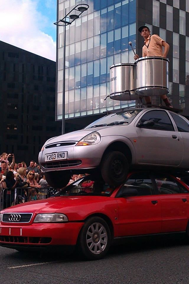 Away from the Kazimier, Rob Lewis can be found drumming atop of two cars while trailing Giants around Liverpool