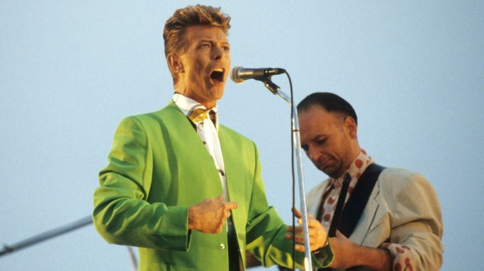 David Bowie performing with Tin Machine guitarist Reeves Gabrels in 1991. Kevin.Mazur/WireImage/Getty Images